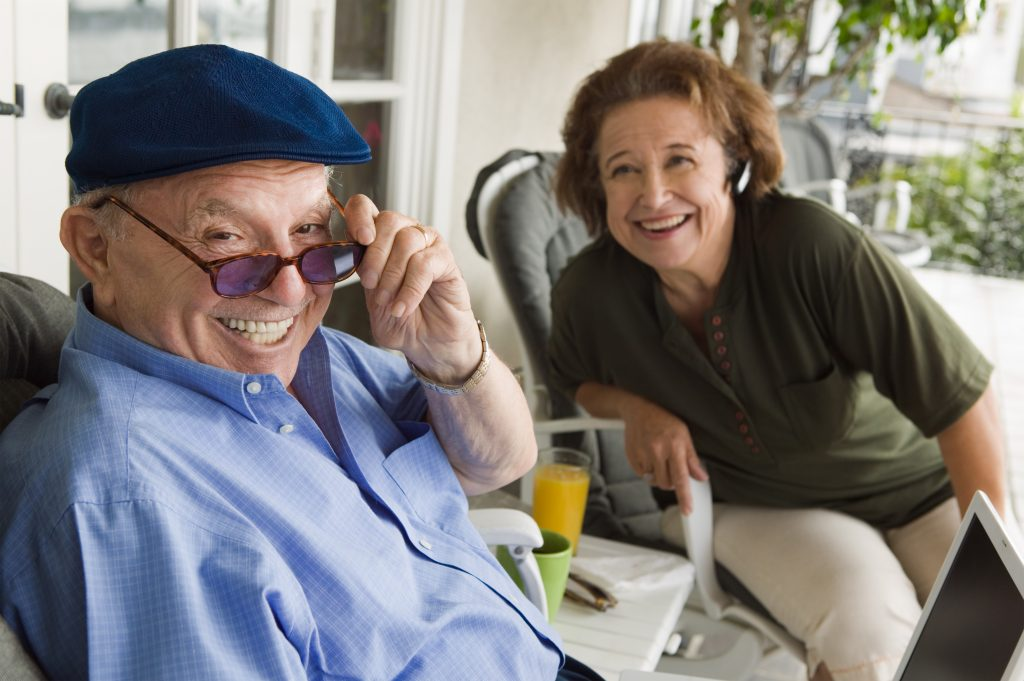 senior couple laughing at the camera