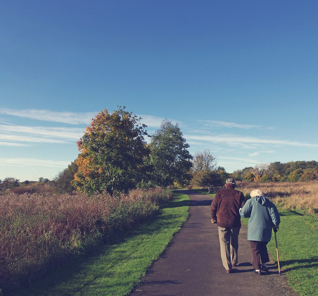 old couple walking on a country lane