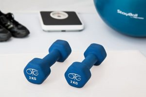 weights, a scale, and ball for rehabilitation