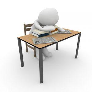 sleeping on desk over books