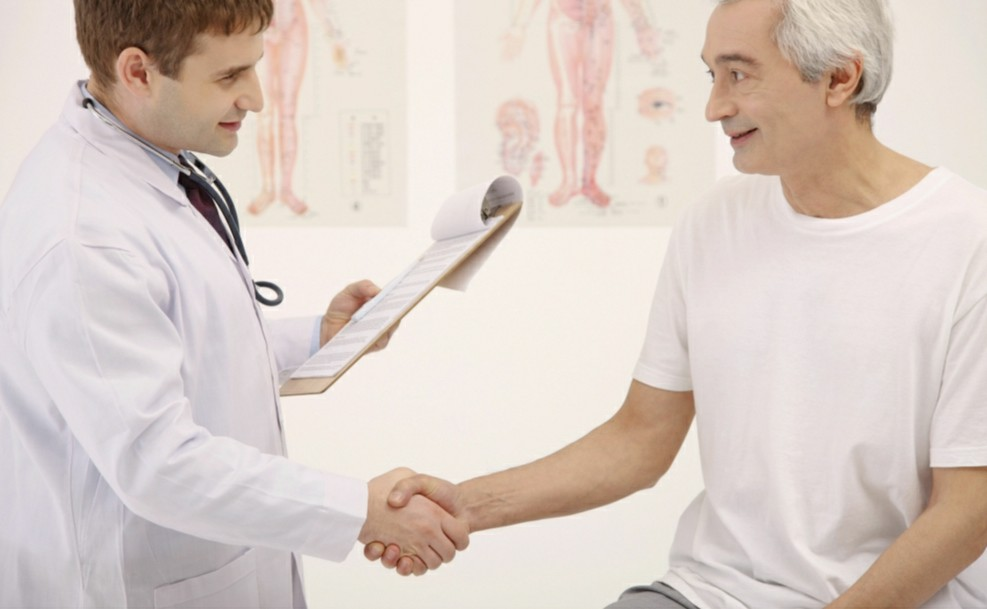 Doctor teaching patient stroke facts